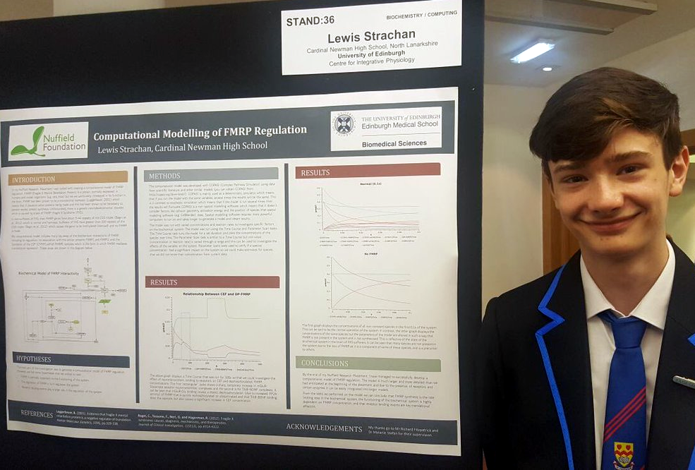 Lewis Strachan presenting his poster